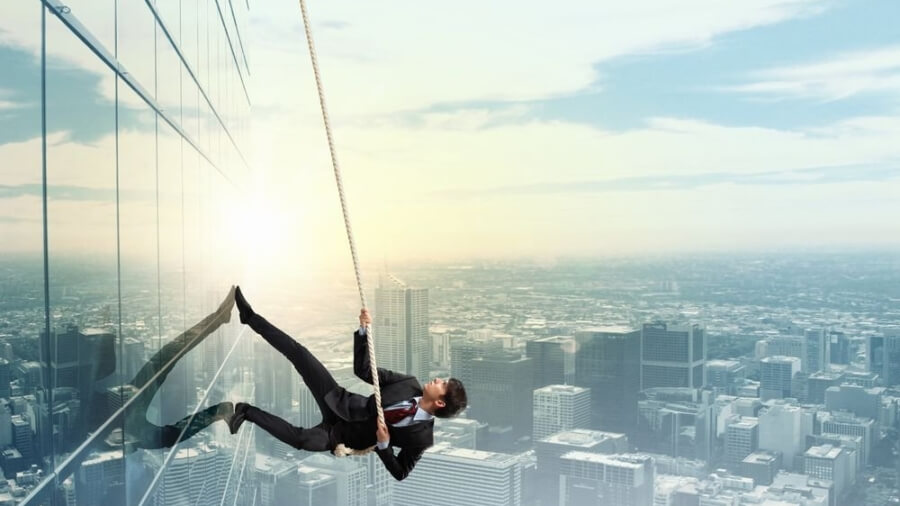 businessman-climbing-building_1024x1024