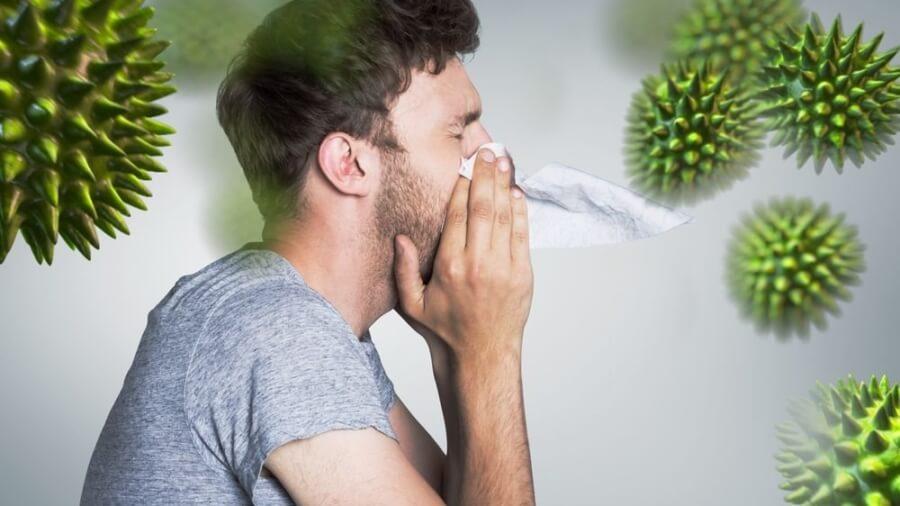 man-blowing-nose-virus_2048x2048