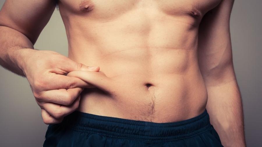 man-pinching-fat-loss-cardio-fit