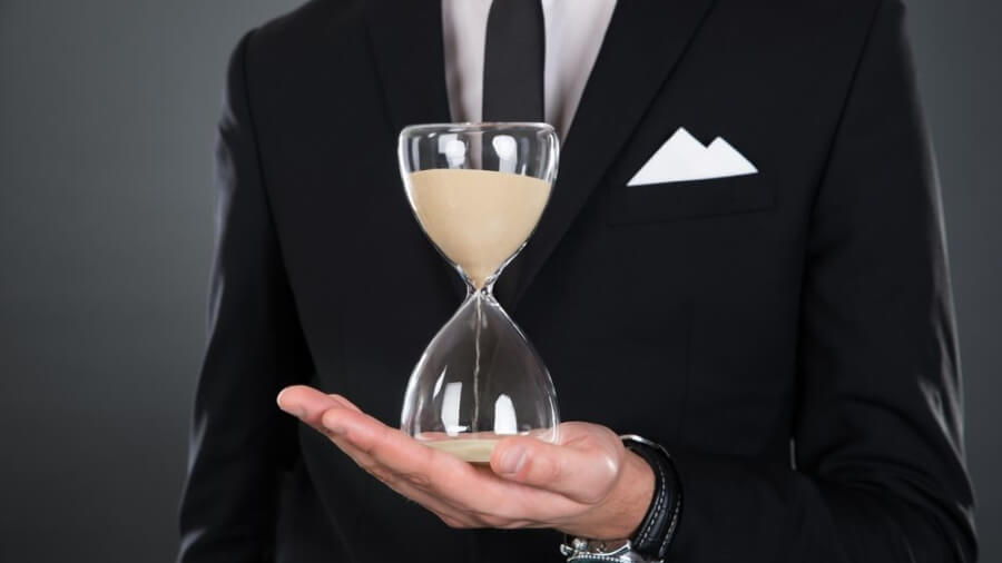business-man-holding-hourglass