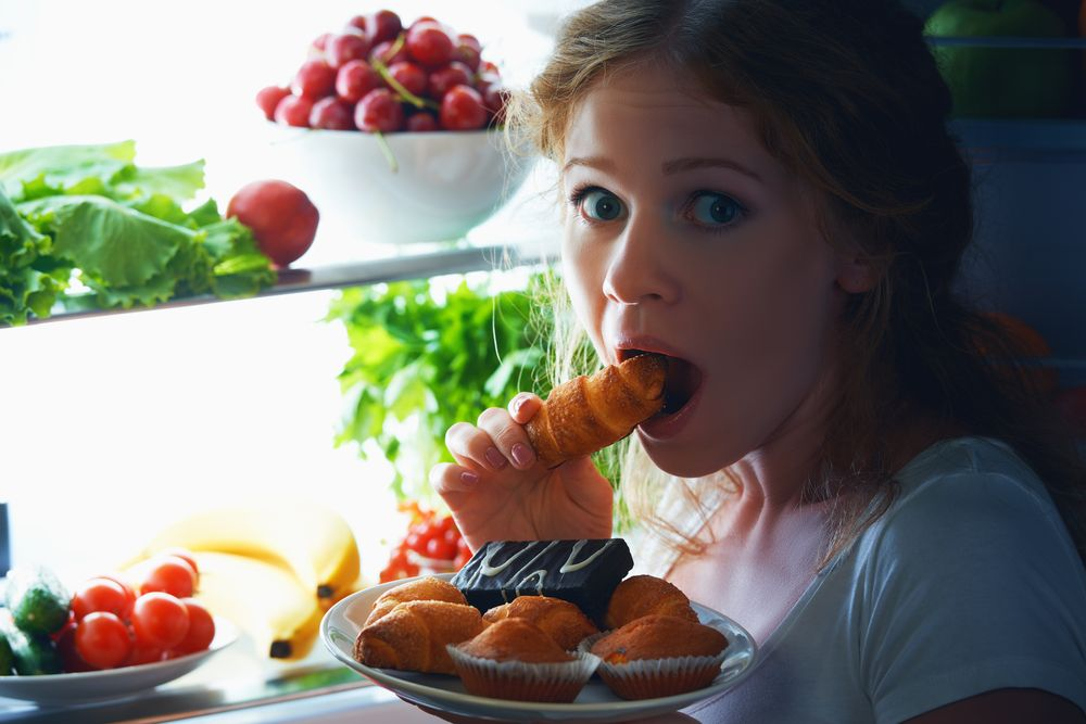 women-eating-food-fridge
