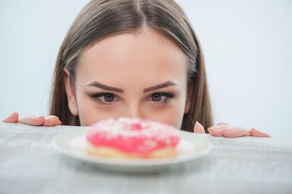 woman-looking-donut-fat